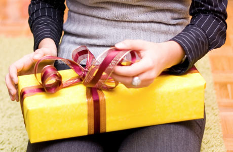 Woman-holding-gift-wrapped-in-yellow460x300